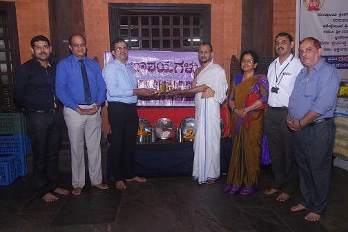 Donation of steel plates and tumblers to temple